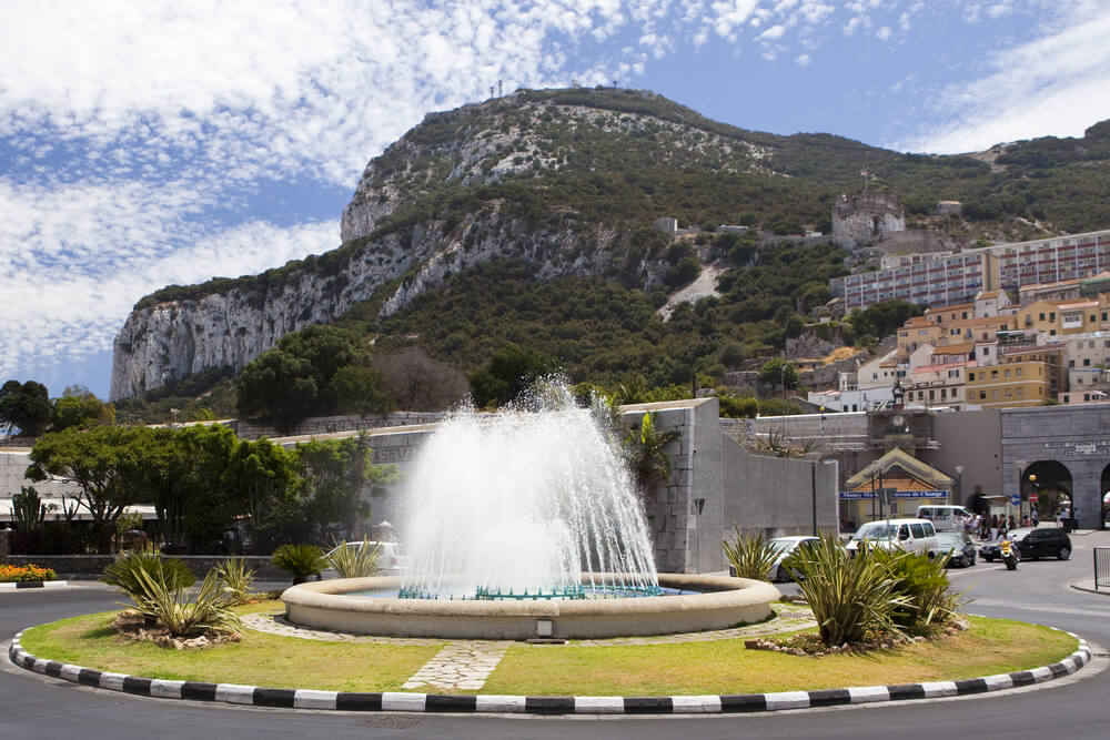 Gibraltar fountain on roundabout near Casemates Square with Rock of Gibraltare